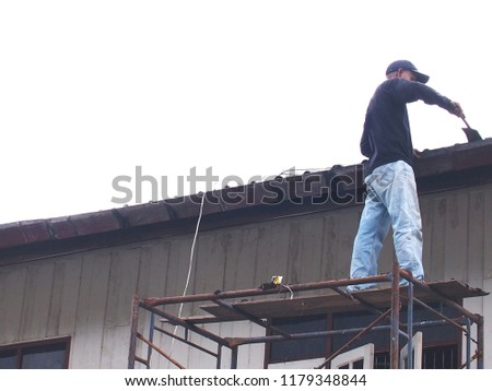 A man repairing the roof. #1179348844