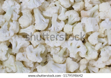 Small pieces of cauliflower in a real image. Heads, cauliflower inflorescence. Vintage of cauliflower. Fruits of cauliflower.  #1179598642