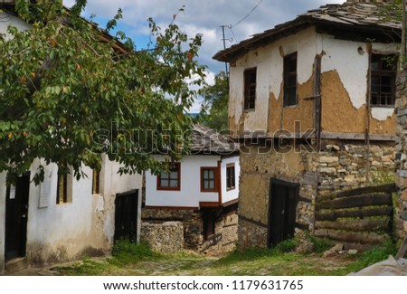 Old houses in the historical cultural reserve village of Dolen, Bulgaria. Dolen is famous with its 350 old houses – an example of 19th century Rhodopean architecture.  #1179631765
