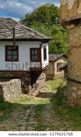 Old houses in the historical cultural reserve village of Dolen, Bulgaria. Dolen is famous with its 350 old houses – an example of 19th century Rhodopean architecture.  #1179631768