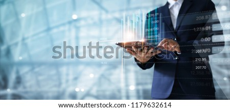 Businessman using tablet analyzing sales data and economic growth graph chart.  Business strategy.  Digital marketing. #1179632614