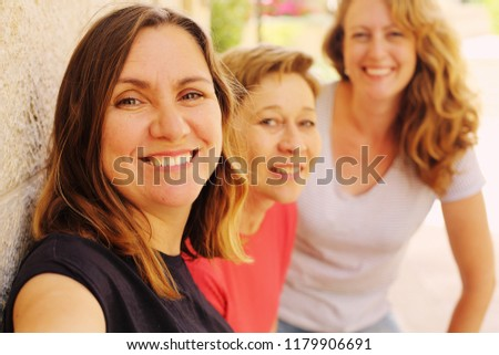 Portrait of beautiful smiling 45 years old woman #1179906691
