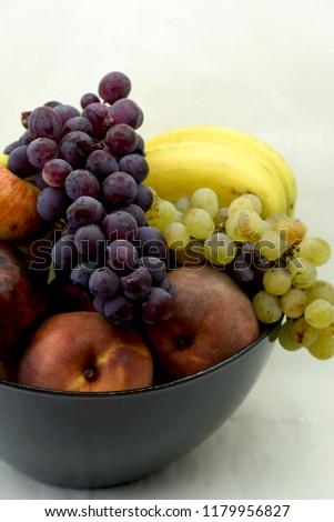 ripe fresh fruit in a bowl #1179956827