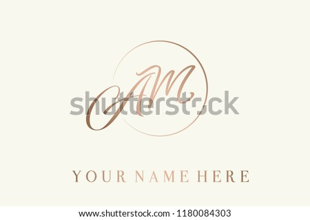 AM calligraphic monogram in rose gold metallic color.Logo with elegant letter a and letter m in a circular frame.Emblem style lettering vector icon isolated on light background. Royalty-Free Stock Photo #1180084303