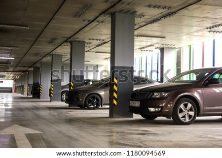 Parking in a residential building. Covered underground parking for cars #1180094569