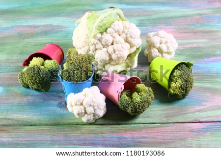 Fresh green broccoli in metal buckets on a colored wooden background. Authentic lifestyle image. Top view with copy space. #1180193086