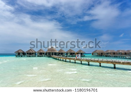 Luxury Water Villas (Bungalows) on the Perfect Tropical Island, Beautiful white sand on Tropical beach, blue water blue sky, Velassaru- Maldives islands  #1180196701
