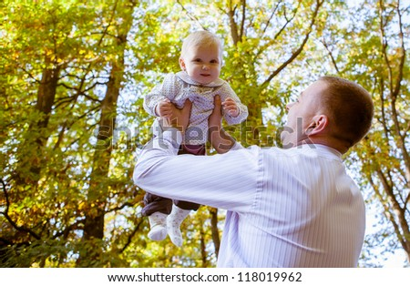 Happy father and his baby daughter having fun in the park #118019962