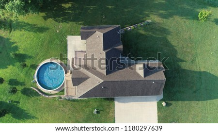 Aerial Overhead Shot of House, yard and pool real estate stock