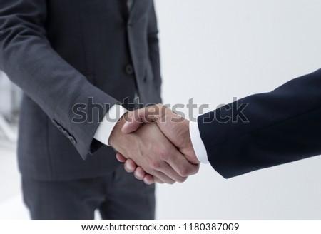 Businessman by handshake invites to cooperation. #1180387009