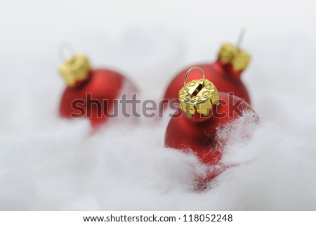 red christmas balls on cotton wool #118052248
