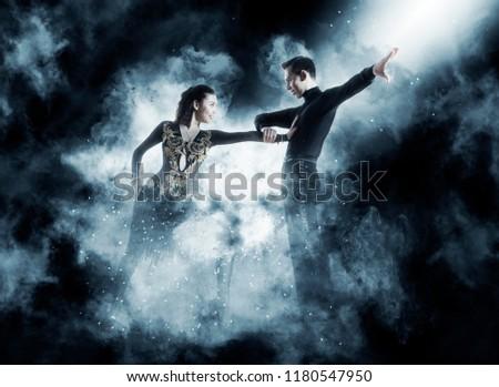 Pair of dancers dancing ballroom dark blue smoke background #1180547950