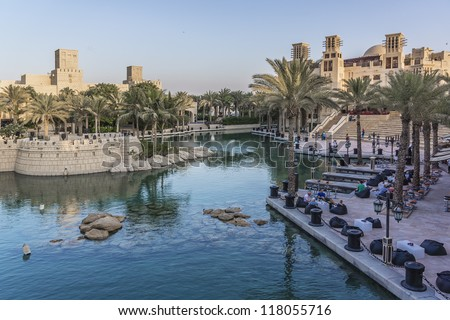 DUBAI, UAE - SEPTEMBER 29: Beautiful views of Madinat Jumeirah hotel, at September 29, 2012, Dubai, United Arab Emirates. Madinat Jumeirah - luxury 5 star hotel with own artificial canals and boats. #118055716
