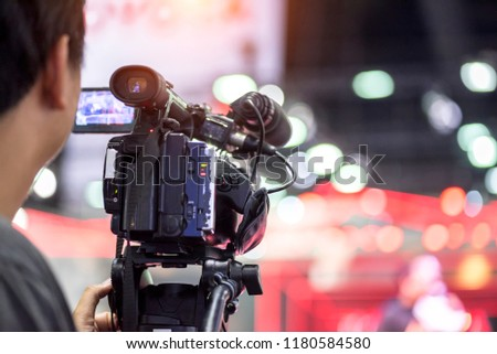 Professional video technician.Videographer working in the event. On air live #1180584580