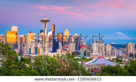 Seattle, Washington, USA downtown skyline at night with Mt. Rainier.