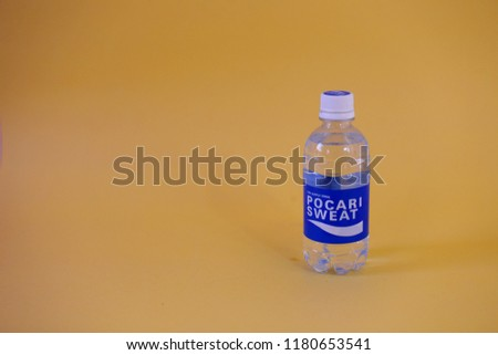drinks pocari sweet isolated with pastel yellow background. yogyakarta indonesia. september 16, 2018. #1180653541