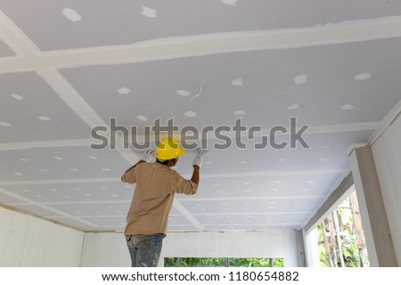 Construction man worker plaster gypsum ceiling for interior build gypsum board ceiling #1180654882