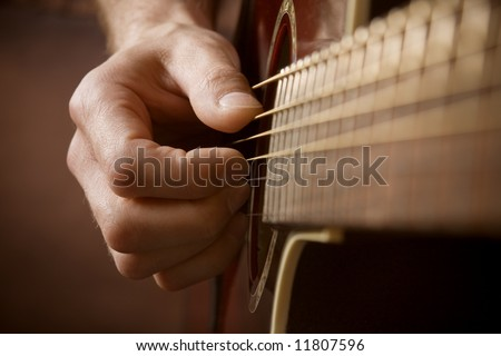 Close up of guitarist hand playing acoustic guitar #11807596