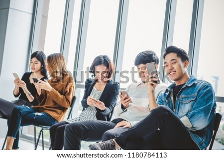 Group of young teen using smart phone for internet online with happy feeling #1180784113