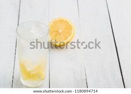 Lemon juice detox water. Mineral water infused with lemons. #1180894714