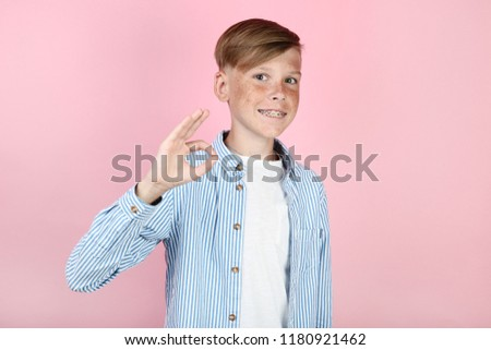 Beautiful young boy with dental braces on pink background #1180921462