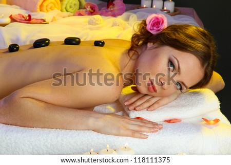 beautiful young woman in spa salon with spa stones #118111375