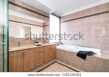 Large clean bathroom with bathtub and luxury fittings in Australian home. Perth, Western Australia, Australia. Photographed: September 2018. #1181220361