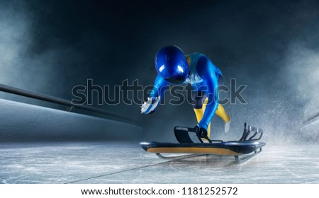 Skeleton sport. The athlete descends on a sleigh on an ice track. Winter sports #1181252572