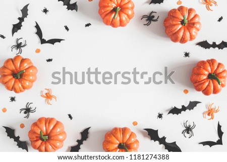 Halloween decorations on pastel gray background. Halloween concept. Flat lay, top view, copy space #1181274388