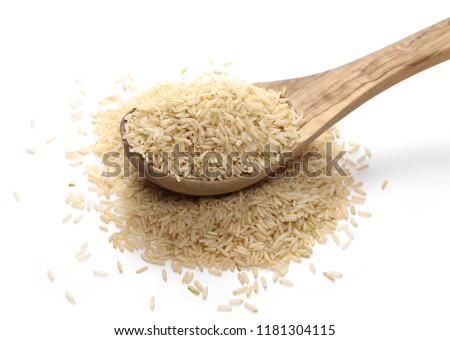 Integral rice pile with wooden spoon isolated on white background #1181304115