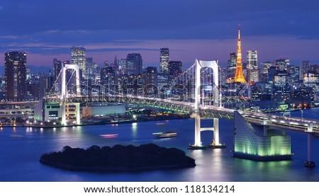 Tokyo, Japan at Rainbow Bridge and Tokyo Bay.