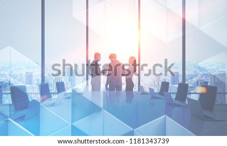 Business people discussing company issues in a large meeting room. Triangular tiles pattern in the foreground. Business success and teamwork concept. Toned image double exposure mock up. #1181343739