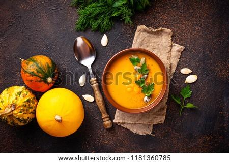 Vegetarian autumn  pumpkin cream soup with seeds #1181360785