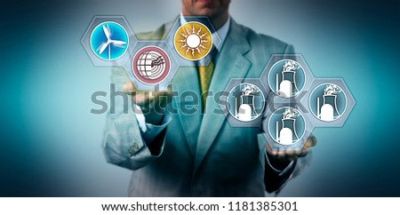 Unrecognizable corporate manager raising renewable energy above nuclear power generation. Industry and business metaphor for Energiewende, energy turn, sustainable resources, green electricity. #1181385301