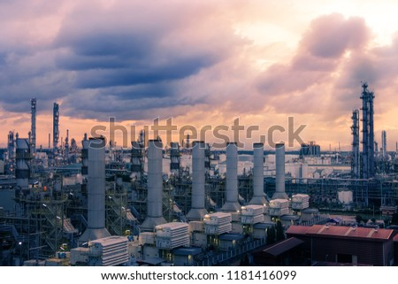 Factory of oil and gas refinery industrial plant at evening, Manufacturing of petroleum industrial plant, Smoke stacks of power plant #1181416099