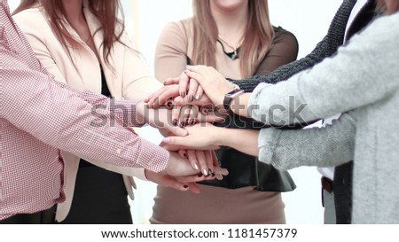 portrait of confident business team stacking hands #1181457379