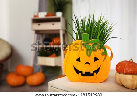 Creative decor prepared for Halloween celebration on table in room #1181519989