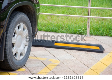 Modern rubber barrier fencing for cars in summer parking in the street #1181628895