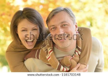 Portrait of happy couple posing in park #1181703148