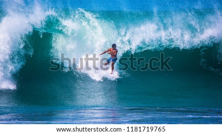Riding the waves. Costa Rica, surfing paradise. Carlos Munoz, world-class professional surfer #1181719765