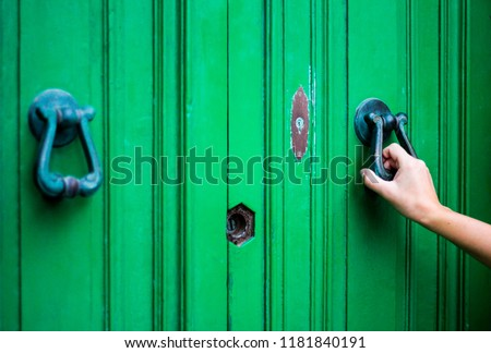 Knocking on the green door, close up #1181840191