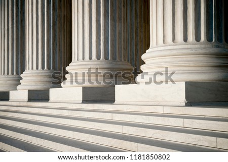Abstract view of neoclassical fluted columns, bases and steps of the US Supreme Court building in Washington DC Royalty-Free Stock Photo #1181850802