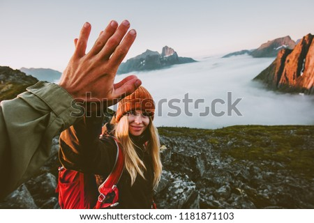 Travel couple friends giving five hands outdoor hiking in mountains adventure lifestyle positive emotions concept family together on journey vacations #1181871103