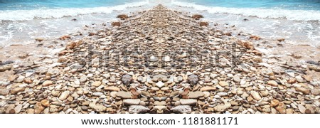 Panoramic view of the cobbled road. Ocean Pictures. Pebbles texture. Rough structure mineral. Rock texture. Background of sea stone. Gravel texture.