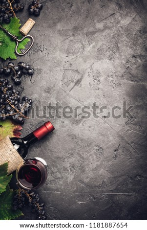 Wine composition on dark rustic background