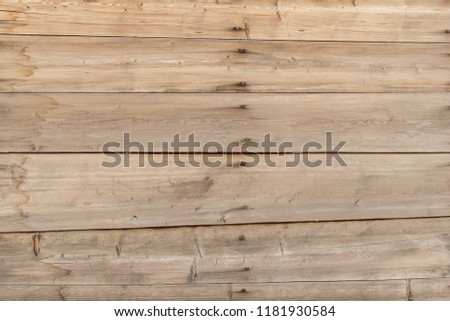 Texture of an old fence made of wooden boards with knots and rusty nails #1181930584