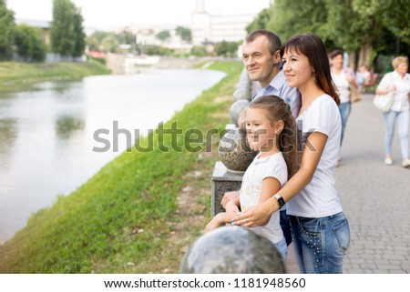daughter with parents. daughter mom and dad by the river. walk in the Park. summer #1181948560