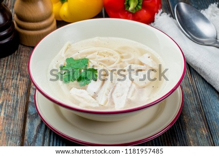 Chicken soup bouillon in a plate #1181957485