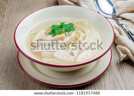 Chicken soup bouillon in a plate #1181957488