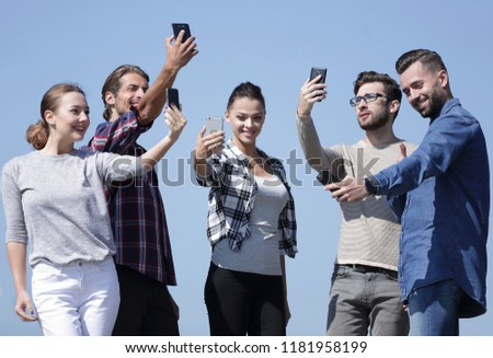 group of young people taking a selfie. #1181958199